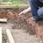 Laying brick path edge
