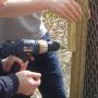 Drilling chicken enclosure latch