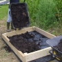 Infilling raised beds with compost