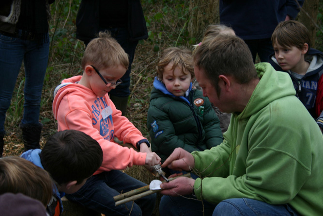 Learning to light a  fire with a flint